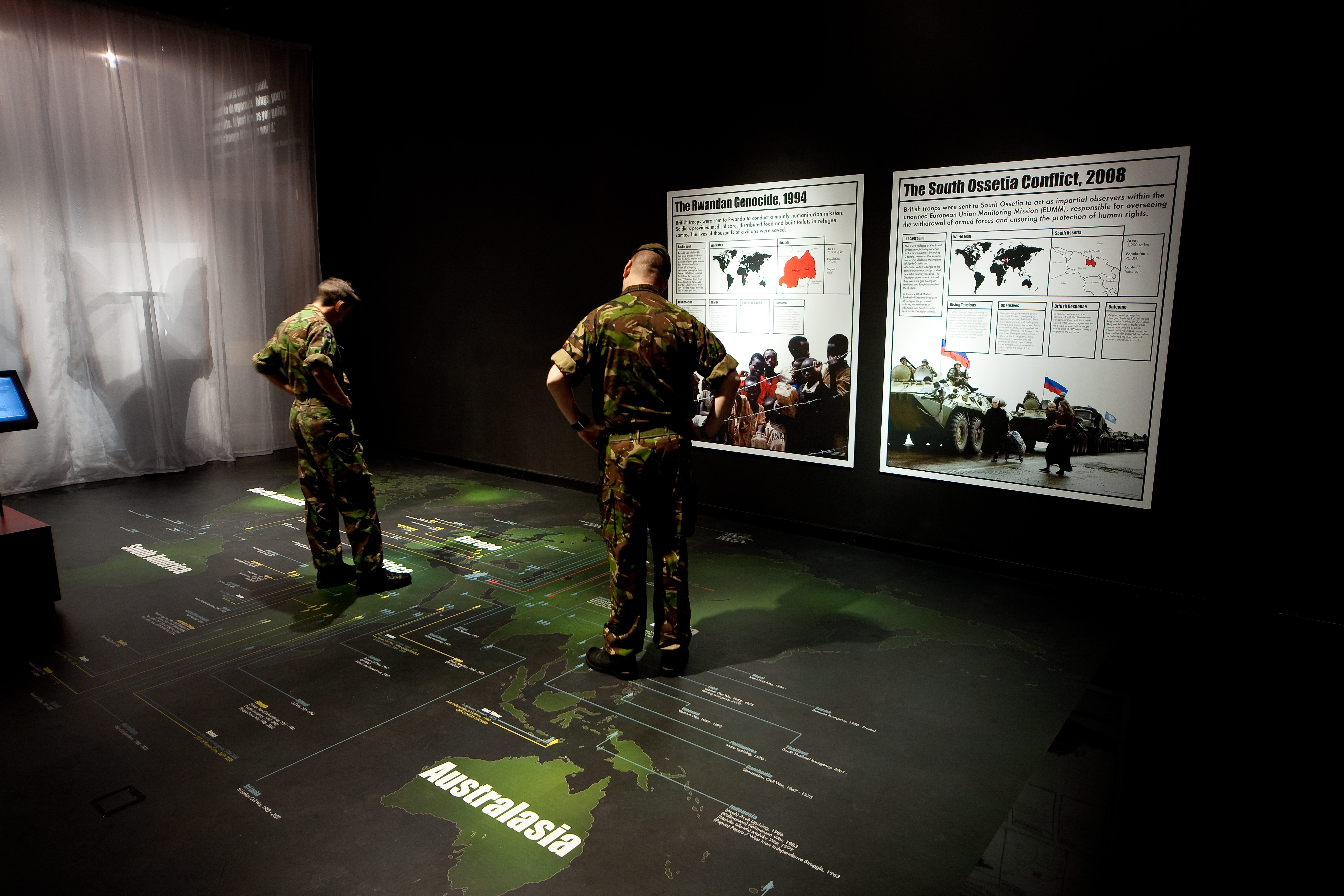 48 - Soldiers looking at conflicts map