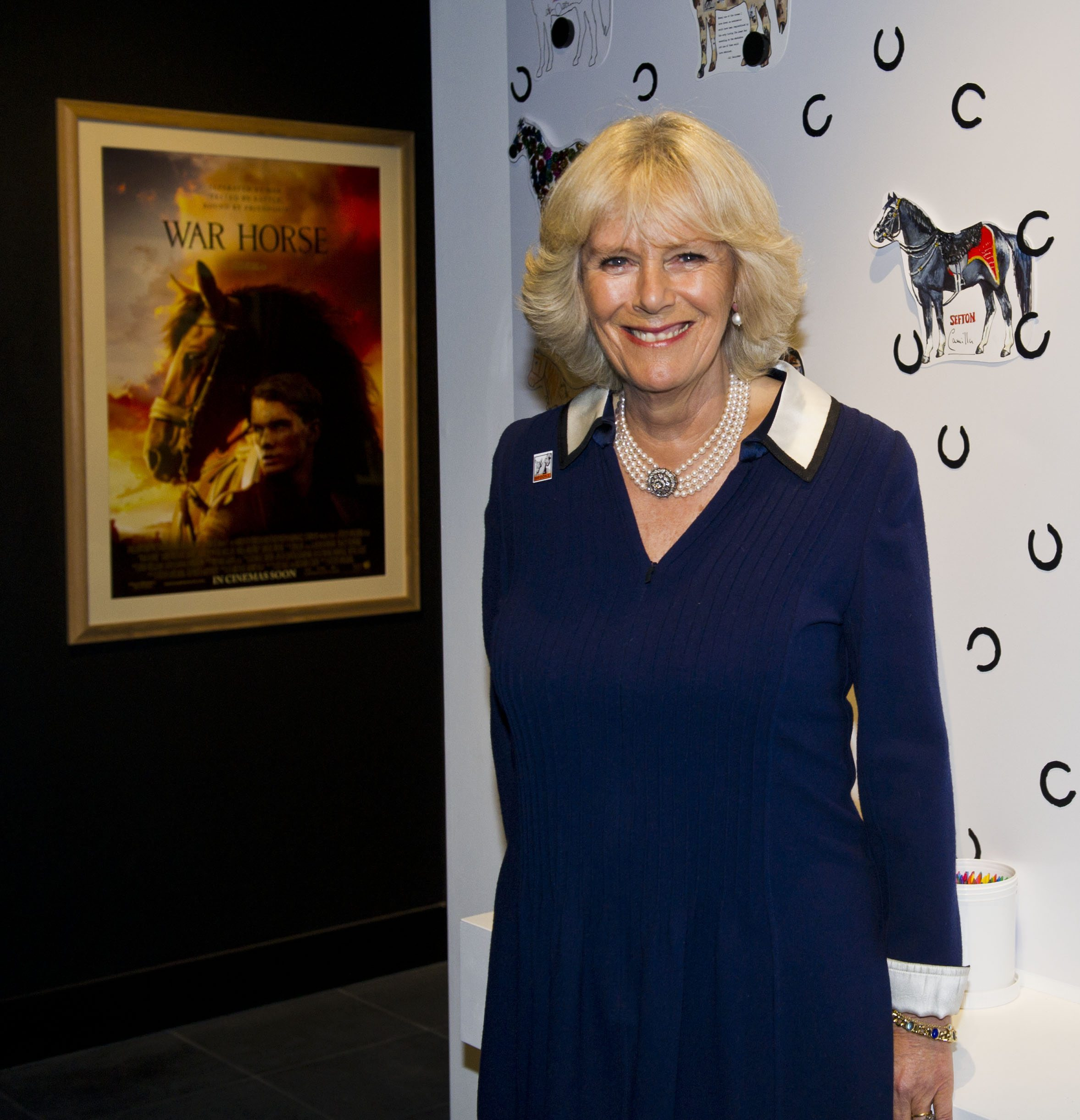 HRH The Duchess of Cornwall, President of the Brooke, joins Michael Morpurgo and supporters from the National Army Museum, the Brooke to celebrate the real-life horse heros at the Opening of the War Horse: Fact & Fiction exhibition at the National Army Museum on 19 October 2011